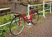 Red Bicycle Beside a Canal in Netherlands — Stock Photo