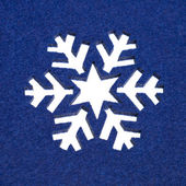 Snowflake Pattern Cut Out From Fluffy Blue Felt — Stock Photo