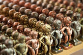 Rows of Manneken Pis Metallic Replicas in different Colors — Stock Photo