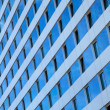 Blue Sky Reflected in Windows of a Skyscraper — Stock Photo