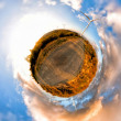 Windmills on little planet alternative energy concept - Stock Photo