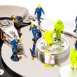 Group of engineers maintaining hard drive — Stok fotoğraf
