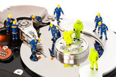 Group of engineers maintaining hard drive — Photo