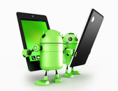 Androids with tablet — Stok fotoğraf
