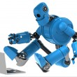 Robot with laptop — Stockfoto