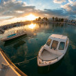 Small fishing boat at sunset — Stock Photo