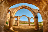 Arch and columns at Agios Sozomenos temple — Stock Photo