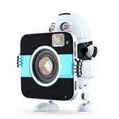 Robot walking with digital camera — Stock Photo