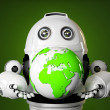 Robot holds earth globe. — Stock Photo