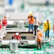 Team of engineers repairing circuit board — Stock Photo #42979305