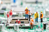 Team of engineers repairing circuit board — Stock Photo