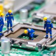 Group of construction workers repairing CPU — Stock Photo #42982133