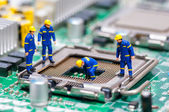 Group of construction workers repairing CPU — Stock Photo