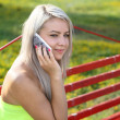 Girl speaks by  mobile phone. — Stockfoto