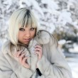 Girl in winter park. — Stock Photo