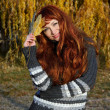 Girl with red hair, in autumn park. — Stock Photo