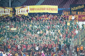 Galatasaray fans celebrating goal, in CFR Cliuj-Napoca vs Galatasaray istambul footbal match — Stock Photo