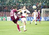 Cadu and Umut Bulut in CFR Cliuj-Napoca vs Galatasaray istambul footbal match — Stock Photo