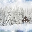Christmas background with snowy house on the hill - Stock Photo