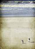 Vintage seascape of long deserted beach with golden sand — Stock Photo