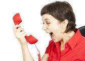 Businesswoman screaming into a phone — Stock Photo