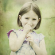 Old photo of little girl in spring field — Stock Photo