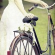 Bride and wedding bouquet on a bicycle — Stock Photo #29019813