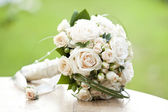 Vintage photo of white wedding bouquet — Stock Photo