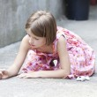 Back to school concept - Photo of girl writing with chalk on the schoolyard — Stock Photo #29941145