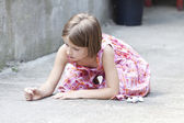 Back to school concept - Photo of girl writing with chalk on the schoolyard — Stock Photo