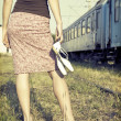 Barefoot girl at the railways — Stock Photo