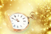 Gold clock showing midnight — Stock Photo