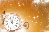 Old clock with stars and snowflakes — Stock Photo