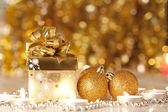 Gift box, candles and Christmas balls — Stock Photo