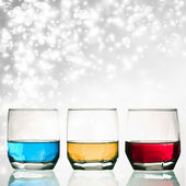 Glasses of shots on abstract background — Stok fotoğraf