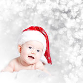 Portrait of a baby with Santa hat isolated on holiday background — Stock Photo