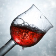 Red wine against and holiday lights  — Stock Photo