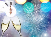 Glasses with champagne against fireworks and clock — Photo