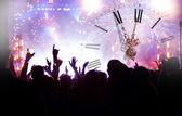 Clock close to midnight, fireworks and crowd waiting for New yea — Stock Photo