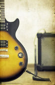 Guitar and amplifier - old styled photo — Stock Photo