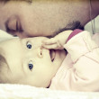 Father kissing her little baby girl — Stock Photo #40106027