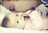 Father kissing her little baby girl — Stock Photo