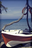 Vintage photo of a lonely boat — Stock Photo