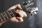 Hands on guitar neck — Stock Photo