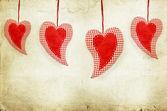 Red hearts on vintage paper background — Zdjęcie stockowe