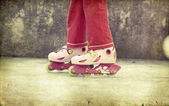 Girl riding on roller skates — Stock Photo