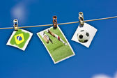 Soccer ball, player and Brazil flag — Stock Photo