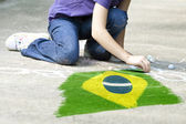 Child drawing Brazil flag — Stock Photo