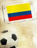 Photo of Colombia flag and soccer ball — Stock Photo