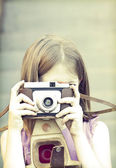 Little girl taking picture — Stock Photo
